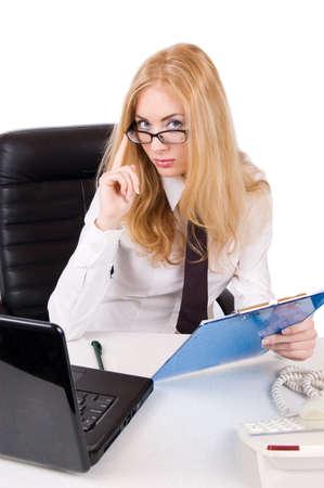Seductive businesswoman in glasses near laptop over white photo