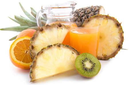 Jug and glass of multivitamin juice with pineapple and orange Stock Photo - 11041696