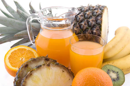 Jug and glass of multivitamin juice with pineapple and orange Stock Photo - 11041697