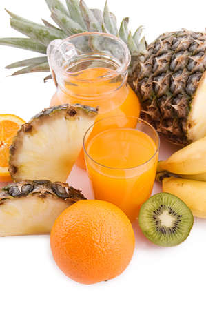 Jug and glass of multivitamin juice with pineapple and orange Stock Photo - 11195312