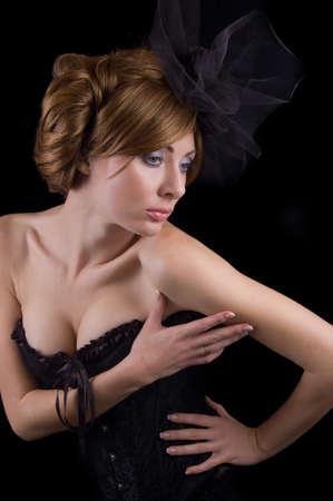 Graceful retro-style woman isolated on black photo