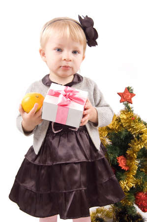 Cute little girl with Christmas tree and gifts over white Stock Photo - 11531674
