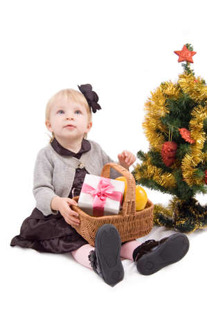 Little girl with Christmas tree and giftsover white Stock Photo - 11531676