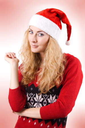 Pretty woman in Santa hat over light red back Stock Photo - 11633627