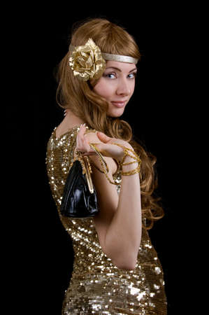 Retro styled woman in dress with sparkles over black photo