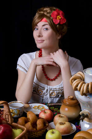 Russian woman drinking tea with samovar on black Stock Photo - 12016796