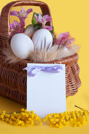 Happy Easter greeting card with eggs and spring flowers photo