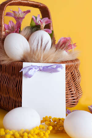 Happy Easter card with basket of eggs and spring flowers Stock Photo - 12873699
