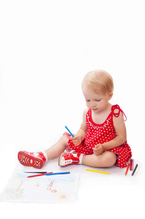 Little baby girl drawing at her album over white Stock Photo - 12873707