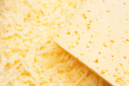 Cheese closeup and its shavings in plate photo