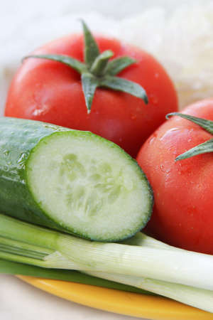 Salad ingredients with tomato, onion and cucumber photo