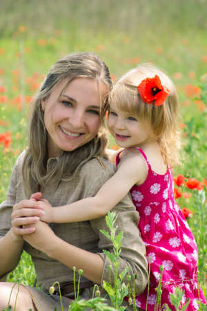 Happy mother and daughter in poppy field Stock Photo - 13990973