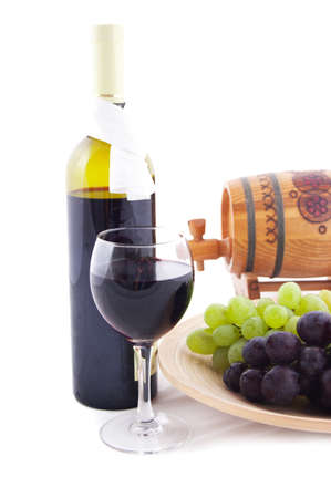 Red wine bottle, glass and cask with grapes over white photo