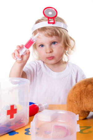 otoscope: Little girl playing as doctor with syringe on white Stock Photo