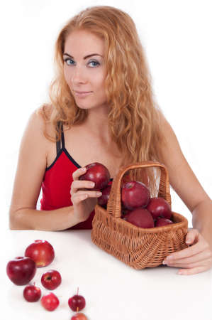Redheaded woman with basket of apples over white photo