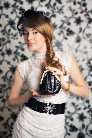 Glamorous retro-styled woman with handbag photo