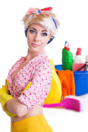Pinup styled housewife with cleaning set on white photo