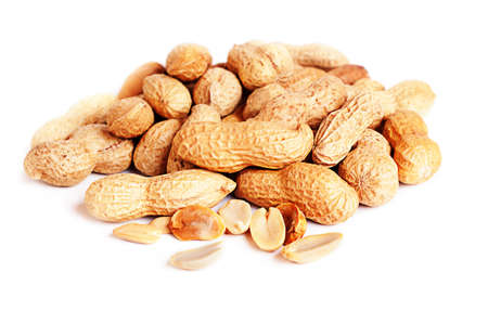 earthnut: Pile of groundnuts on a white background