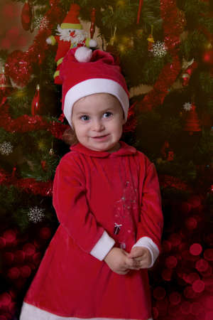 Baby girl Santa Helper under Christmas tree photo