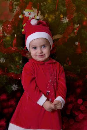 Baby girl Santa Helper under Christmas tree photo
