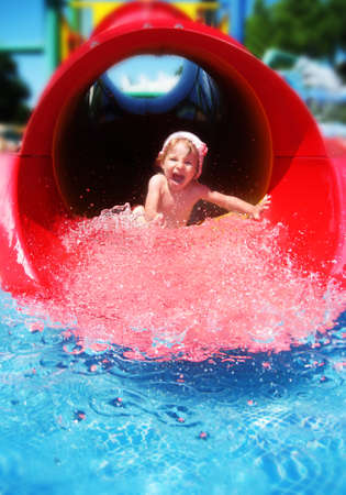Screaming girl riding down the water slide Stock Photo - 16972292