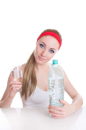 Sporty woman with bottle and glass of pure water over white photo