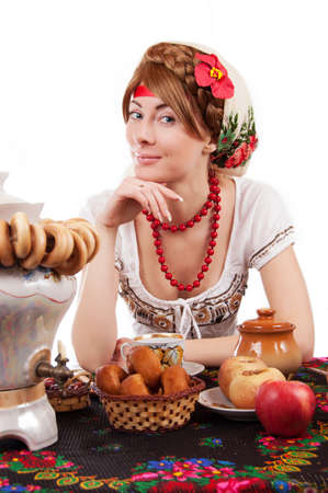 Hospitable russian woman welcomes to drinking tea with samovar over white photo