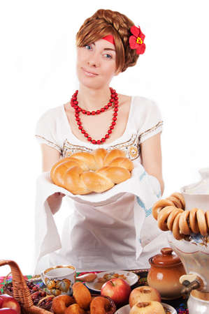 Hospitable russian woman offering traditional loaf over white Stock Photo