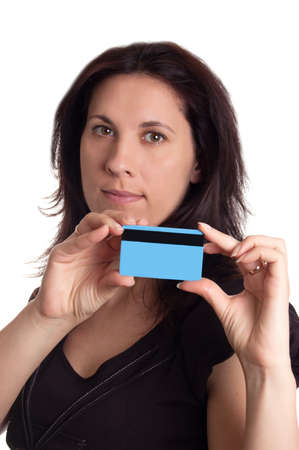 Serious woman holding blue credit card isolated on white photo