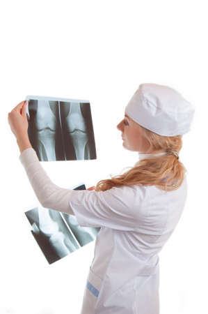 Female doctor examining x-ray isolated on white photo