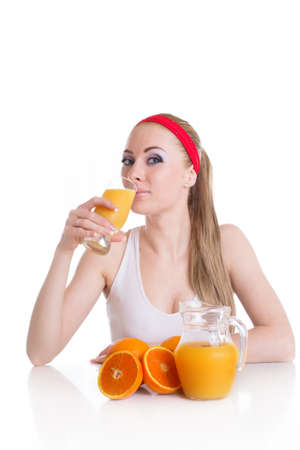 Sporty woman drinking orange juice and fruits, isolated health concept photo