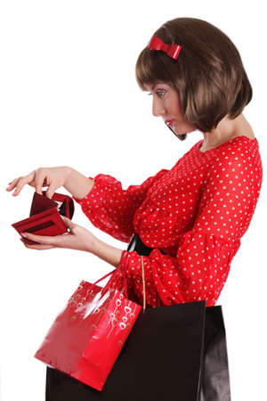 Woman with shopping bags and no money in purse over white Stock Photo