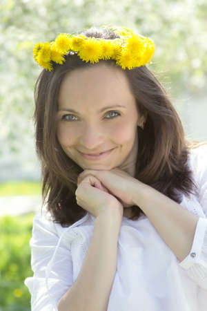 Sensual lovely woman with dandelion wreath in spring photo