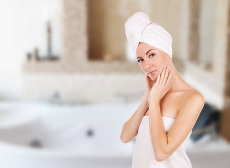 Sensual woman with towel in bathroom with jacuzzi photo