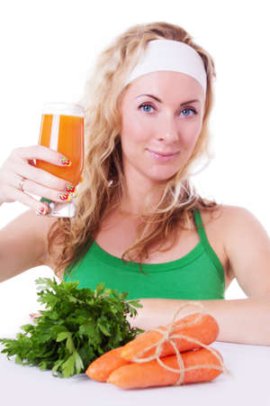 Sporty woman holding carrot juice and greens isolated on white photo