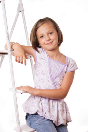 seven persons: Cute smiling girl sitting on steps over white