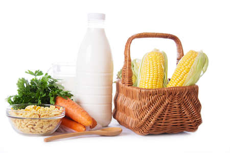 Milk, cereals and some vegetables isolated on white photo