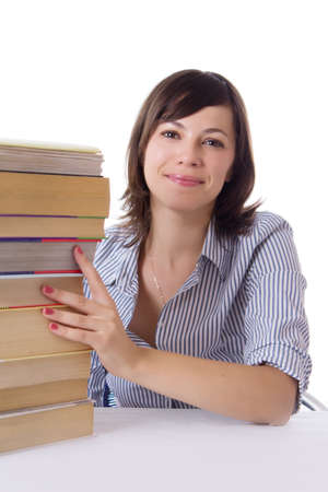 Smiling student girl sitting with pile of books isolated photo