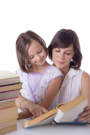 Mother and daughter reading books over white photo