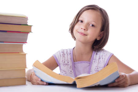 Pretty girl with pile of books isolated over white photo