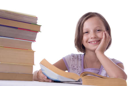 Smiling girl with pile of books isolated on white photo
