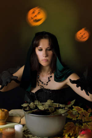 sorcery: Witch practising sorcery at Halloween night