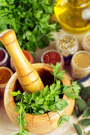 Mortar and pestle, spices on table Stock Photo - 21936096