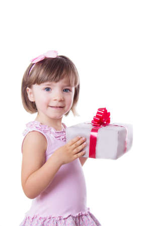 Smiling little girl holding present box over white photo