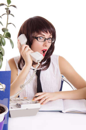 dismayed: Woman assistant receiving some shocking news on phone isolated on white Stock Photo