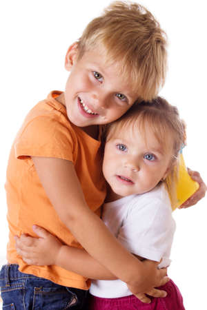 sister: Smiling brother and little sister hugging isolated on white Stock Photo