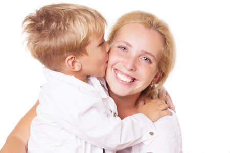 express feelings: Happy mother and son kissing on cheek over white