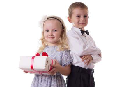 Smiling boy and girl with present box isolated on white photo