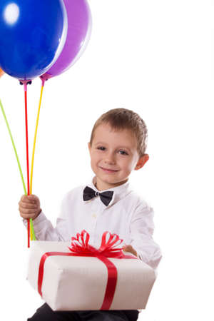 Cute boy with balloons and giftbox isolated on white photo