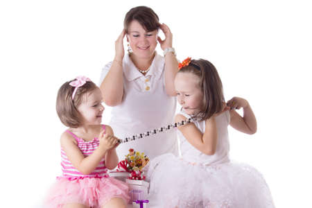 Mother having headache of two daughters quarreling isolated on white photo